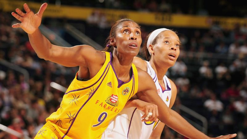 Former Los Angeles Sparks player Lisa Leslie boxes out Tangela Smith, formerly of the Phoenix Mercury in Game 2 of the Western Conference Finals during the 2009 WNBA Playoffs.