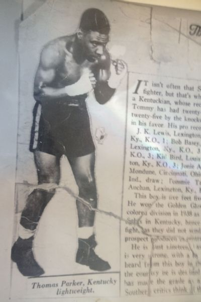 Boxer Thomas Parker featured in a newspaper article.