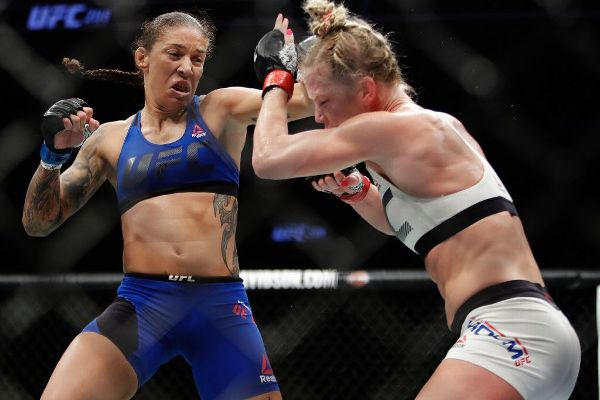 After pulling out a controversial win at UFC 208, Germaine de Randamie, left, says she's more than willing to stage a rematch with Holly Holm.