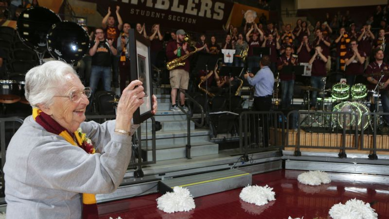 I felt like an Olympian running around the track with the American flag, Sister Jean says of showing off her Loyola Athletics Hall of Fame plaque to students at a basketball game.