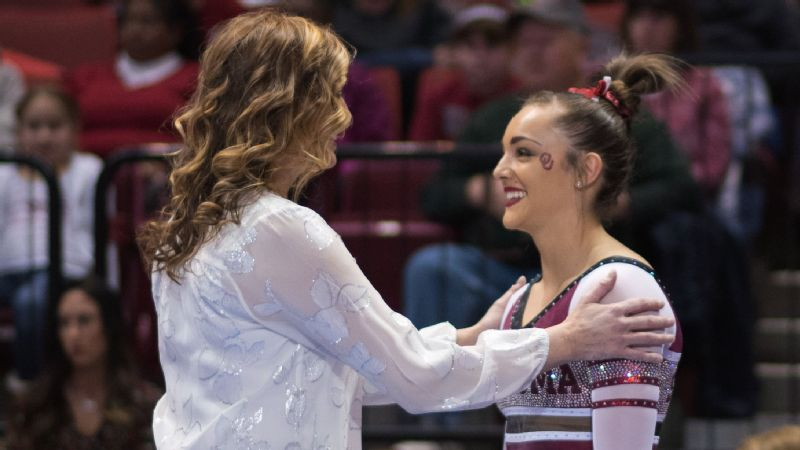 Maggie Nichols, with Oklahoma coach K.J. Kindler, is already the top gymnast in Sooner history -- and she's only a freshman.