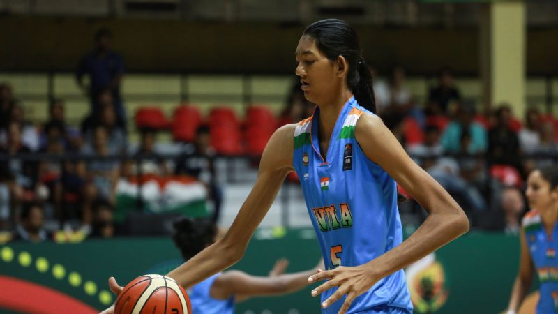 At 611 Poonam Chaturvedi is the tallest member of the Indian basketball team, but with spindly arms and frail built, she often gets pushed around on court.