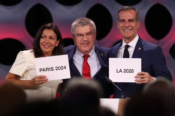 Paris Mayor Anne Hidalgo, IOC President Thomas Bach and Los Angeles Mayor Eric Garcetti react to the confirmation that Paris will host the 2024 Games and L.A. the 2028 Olympics.