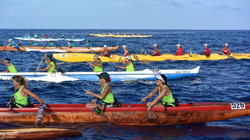 Paddlers line up at the start of the Queen Lili'uokalani Long Distance Outrigger Canoe Races.