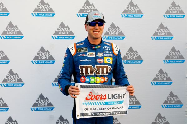 Kyle Busch, driver of the #18 M&M's Caramel Toyota, poses with the Coors Light Pole Award after qualifying in the pole position for the Monster Energy NASCAR Cup Series ISM Connect 300 at New Hampshire Motor Speedway on September 22, 2017 in Loudon, NH.