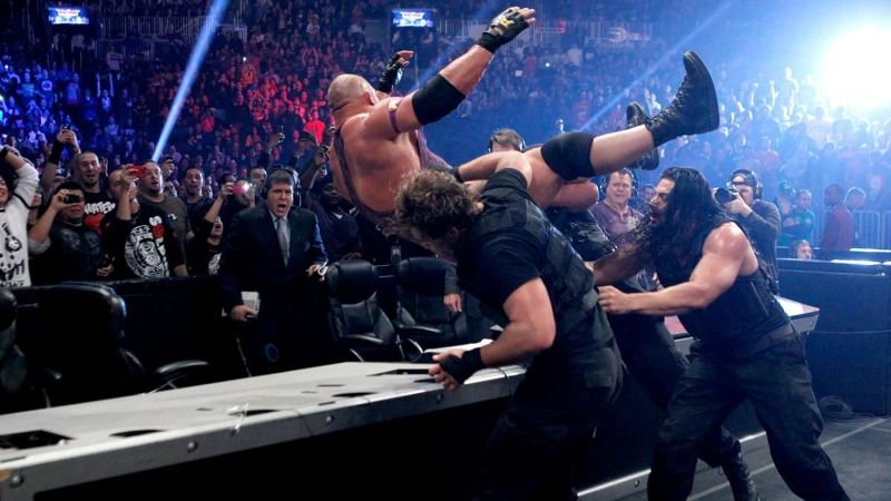 The Shield puts Ryback through a table during their first match at TLC in 2012.