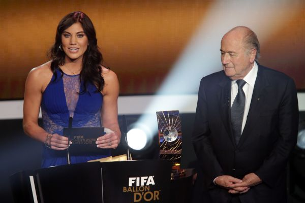 Hope Solo says former FIFA president Sepp Blatter grabbed her buttocks in January 2013, just before they walked onstage together to present Abby Wambach with the 2012 women's world player of the year award.