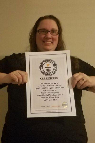 Ragen Chastain holding her Guinness World Records certification.