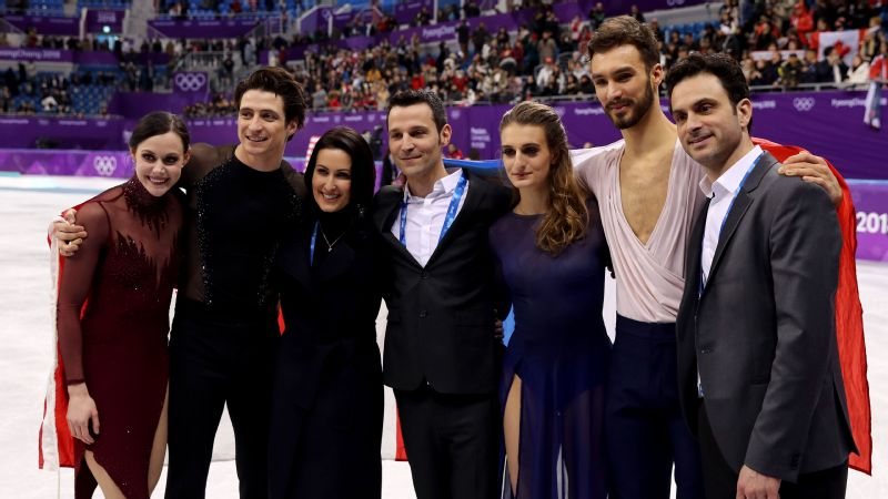 Tessa Virtue and Scott Moir (far left), celebrate their record third Olympic ice dance gold medal with Marie-France Dubreuil (third left) and Patrice Lauzon (far right) and training partners Gabriella Papadakis and Guillaume Cizeron (second from right).
