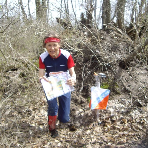Sharon Crawford in the woods, with map and compass at a control site, one of the stations on a course where participants have to find designated flags.
