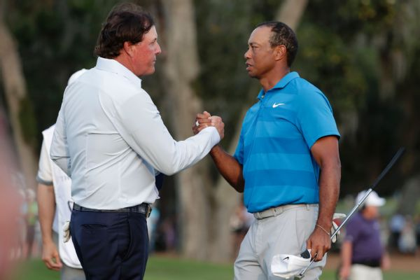 Phil Mickelson and Tiger Woods shaking hands at the Players Championship in May will play in a winner-take-all tournament scheduled for Thanksgiving weekend