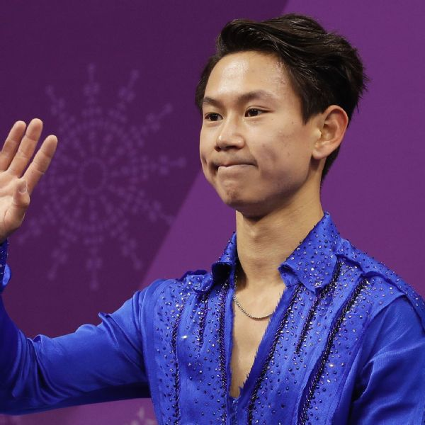 Denis Ten of Kazakhstan reacts as his score is posted following his performance in the men's short program at the 2018 Winter Olympics in South Korea.