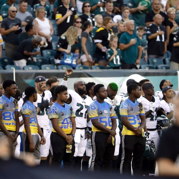 Eagles safety Malcolm Jenkins raises his fist during the playing of the national anthem prior to Thursday night's preseason game against the Pittsburgh Steelers.