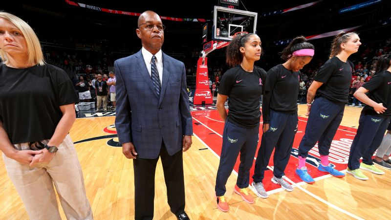 Fred Williams stands during the national anthem before the Dallas Wings faced the Washington Mystics on Sunday.