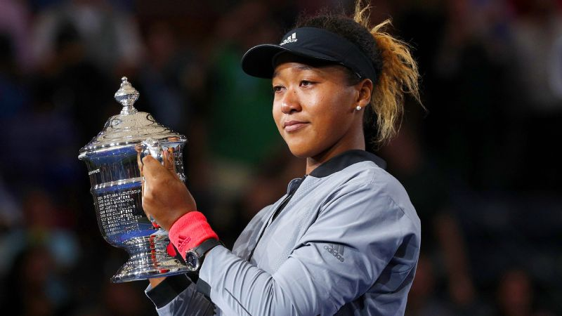Naomi Osaka didn't quite have the glow of a first-time major champion while hoisting the US Open trophy.