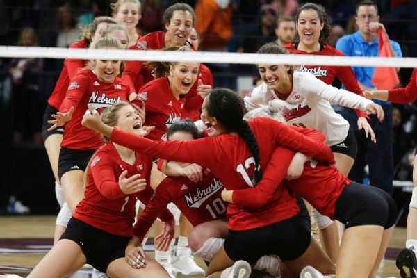 Nebraska players celebrate after defeating Illinois in five sets.