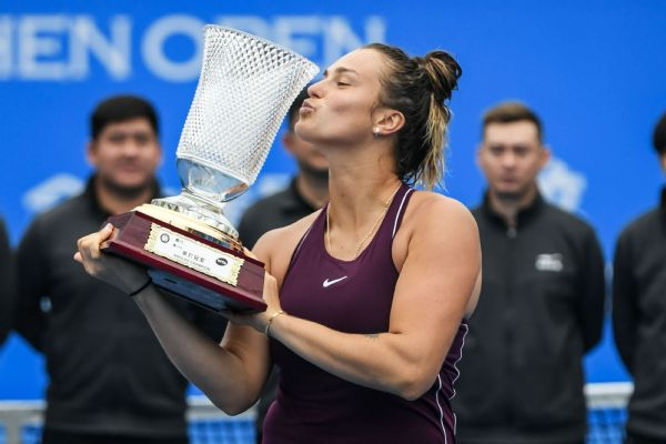 Aryna Sabalenka of Belarus poses with her trophy after winning the women's singles final match in the Shenzhen Open