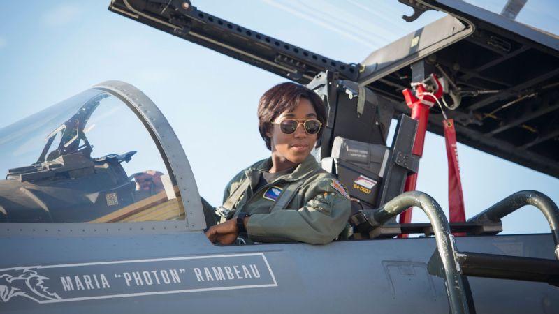 Lashana Lynch plays Maria Rambeau, a U.S. Air Force pilot, alongside Brie Larson as Carol Danvers in Captain Marvel.