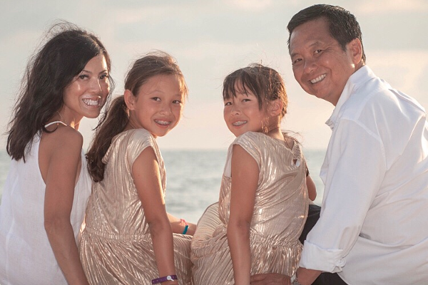 Ann Hirakawa, with her twin daughters, Claire (left) and Grace, and her husband, Howard.