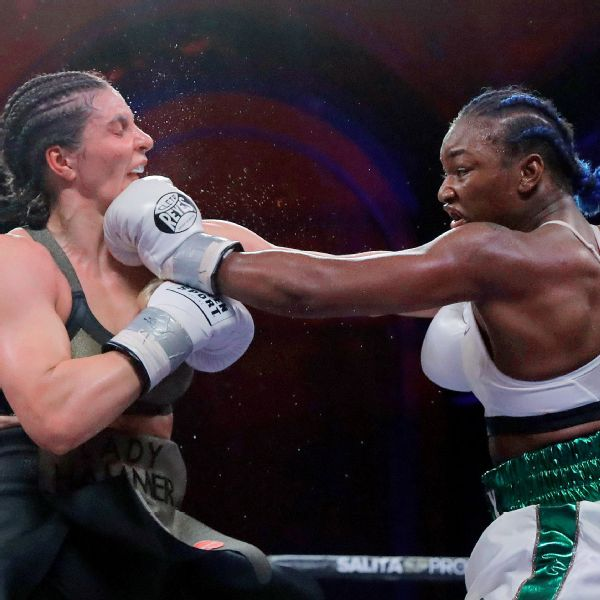 Claressa Shields, right, lands a left to Christina Hammer during the 10th round of Saturday's fight. Shields unified the four major belts with a unanimous-decision victory.
