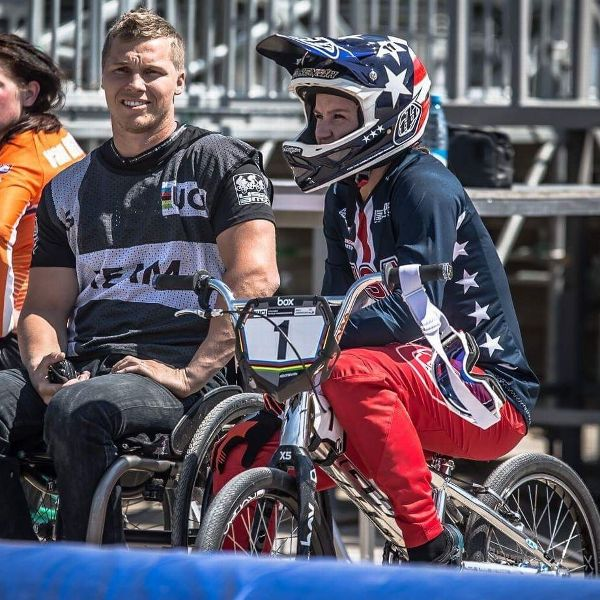 After an accident in 2016 caused paralysis in Sam Willoughby's arms, legs and chest, he began coaching Alise. Alise will look to win gold at the BMX world championships next week.