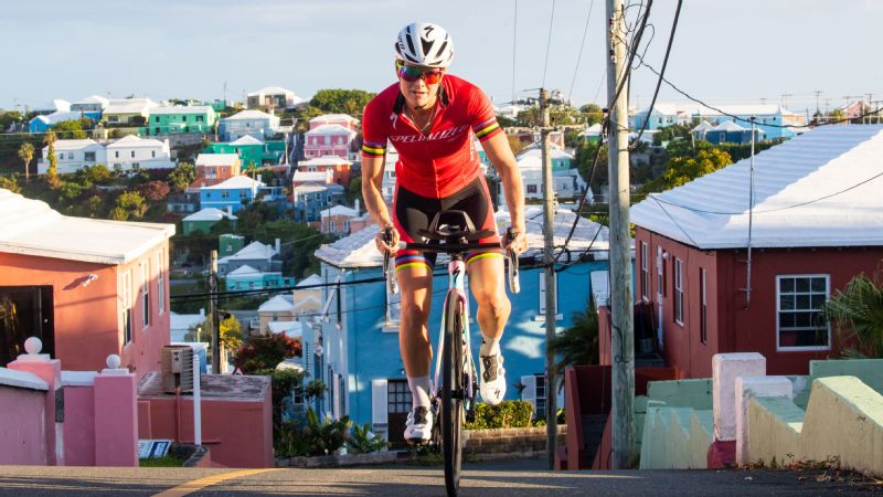 The morning after the ITU World Triathlon Bermuda, Flora Duffy rides through the streets.