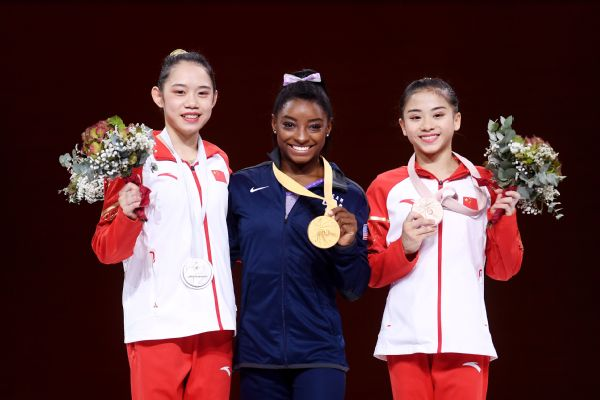 Simone Biles won gold in the balance beam Sunday to give her a record 24 medals in her career at the world championships. She later won gold in the floor exercise for her 25th medal.