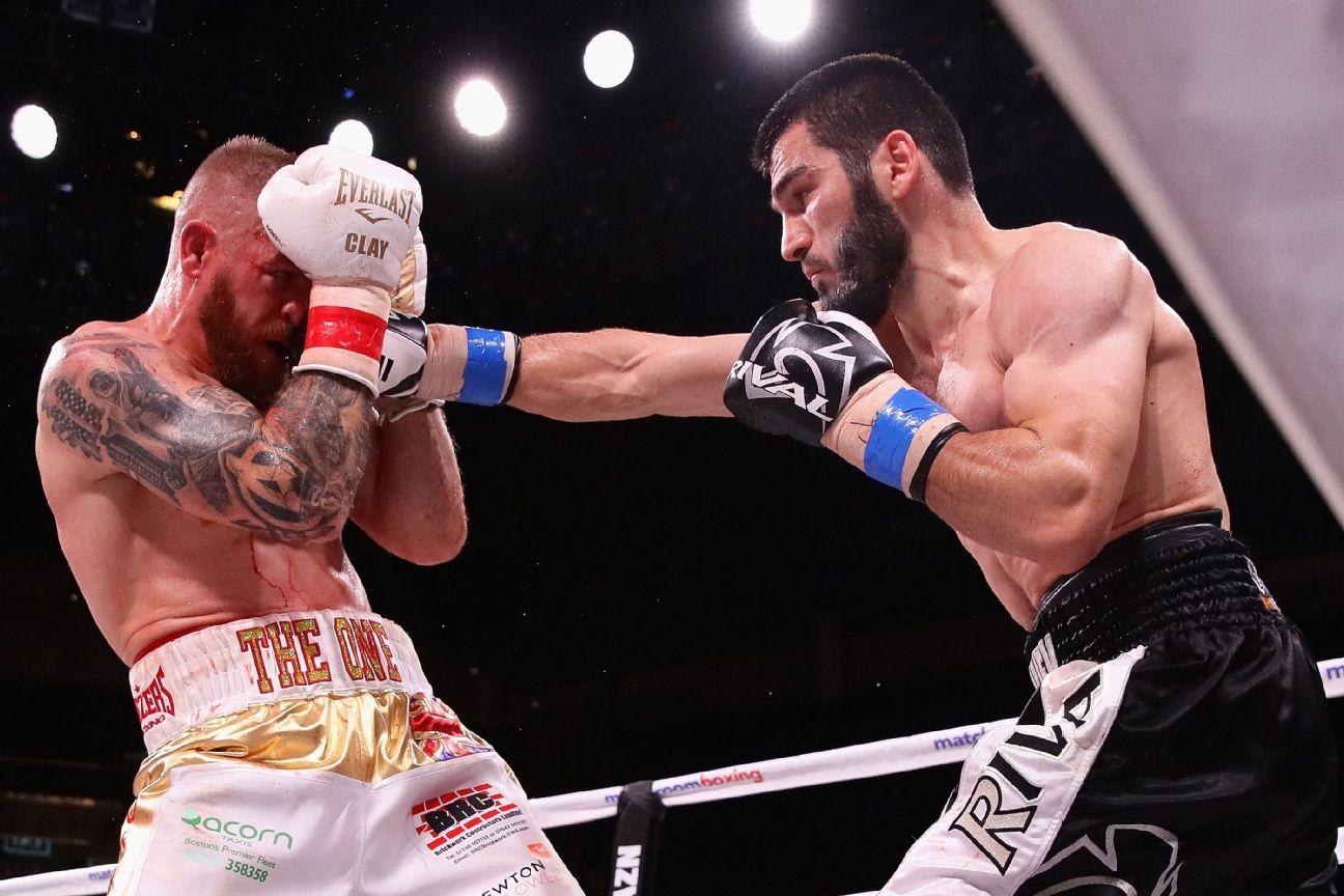 Artur Beterbiev lands a punch against Callum Jonhson during a IBF World Light-Heavyweight title fight at Wintrust Arena on October 6, 2018 in Chicago, Illinois.