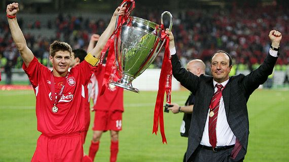 Steven Gerrard and Benitez holding the Champions League trophy in Istanbul.