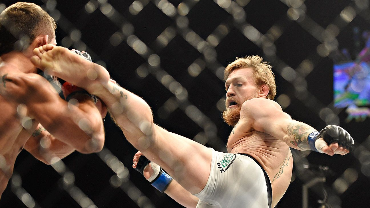 Conor McGregor knocks out Chad Mendes in 2nd round for interim title