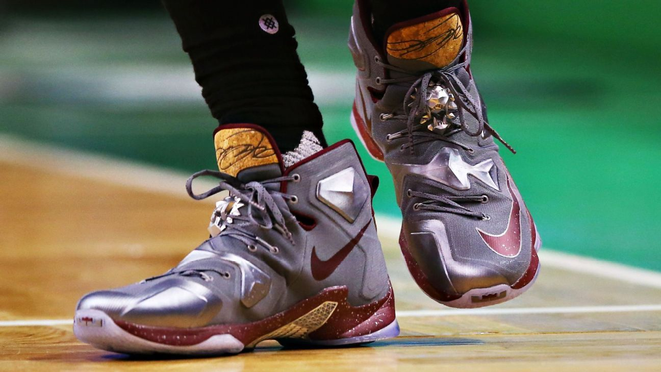 LeBron James of Cleveland Cavaliers gives shoes to ...