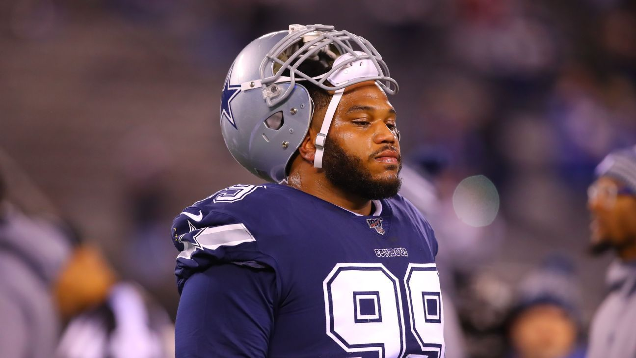 Source: Cowboys cut Woods after drafting 2 DTs